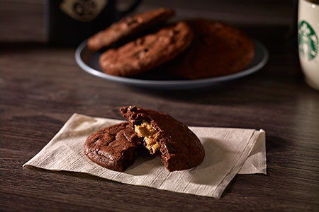 Double Chocolate Peanut Butter Cookie (P65). This chewy cookie has dark chocolate chunks and peanut butter cream.