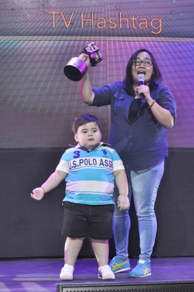 Eat Bulaga's Therese Diaz and Baby Baste accept the award on behalf of the noontime TV show