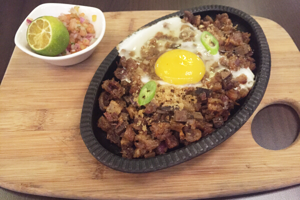 4. Planet Grapes Super Sisig, P210. You have to try this pulutan, which is surprisingly great with red wine. The generous portion of sisig, served with egg on top, has the perfect amount of spice to set off the flavors in wine. It's sinful, super rich, and more on the malaman, not crispy side. It's delicious, with a slight heat that you feel at the back of your throat, and liver emerges as one of the more dominant flavors.