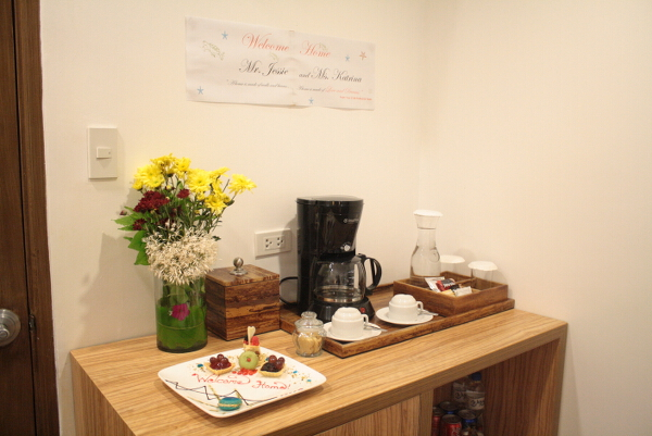 Check out our welcome banner and sweets by the coffee area.