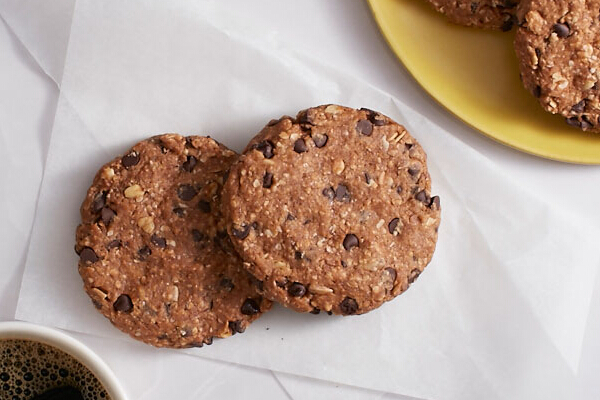 BANANA CHOCOLATE CHIP COOKIE, P60. Banana, granola, oatmeal, and dark chocolate make up this moist and chewy healthy vegetarian cookie.