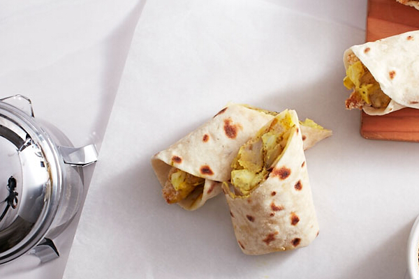 FISH AND POTATO WRAP, P165. This tortilla wrap is filled with moist breaded fish fillet, baked potato wedges, and egg mayo dressing—perfect for Lent.