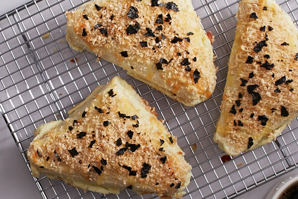 TUNA WASABI TURNOVER, P120. This flour tortilla is filled with wasabi tuna flakes and topped with crunchy Japanese bread crumbs and roasted nori strips.