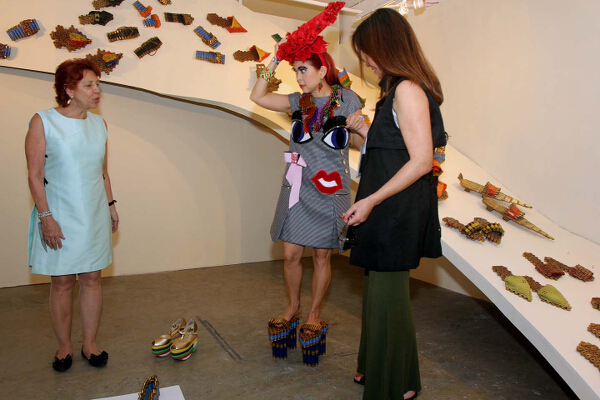 Tessa Prieto-Valdes trying on artsy shoes with Art Fair partners