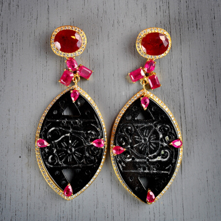 15. Emmilene. Handcrafted earrings with ruby, carved jade, & white topaz