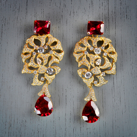 24. Loise. Handcrafted earrings with ruby and white topaz