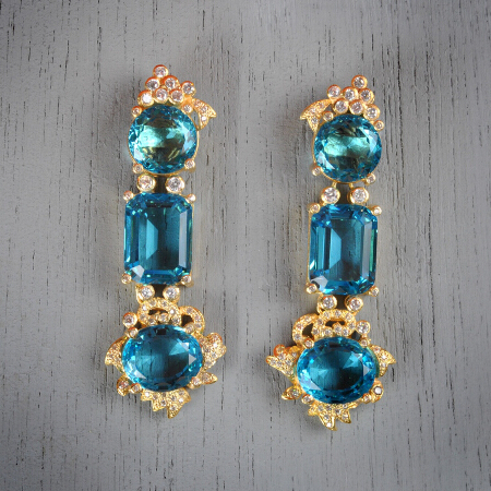 12. Anna. Handcrafted earrings with blue topaz and white topaz