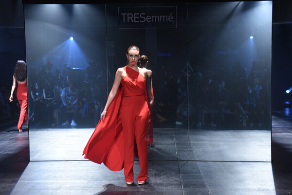 Mark Bumgarner interprets modern elegance in red and nude softly structured ensembles with his signature feminine touch.