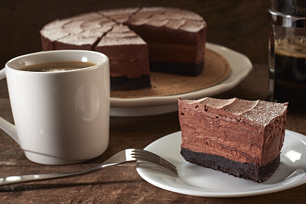 Belgian Chocolate Flourless Mousse Cake, P160/slice, P1,440/whole. It's made of layers of decadent flourless chocolate cake and smooth, creamy chocolate mousse.