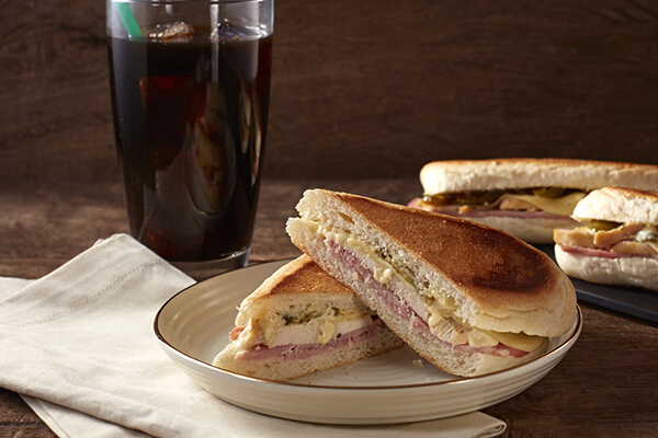 Chicken & Ham Cubano, P175. Pan-grilled bread is filled with roast chicken, ham, cheese, pickles, and pickled jalapeño.