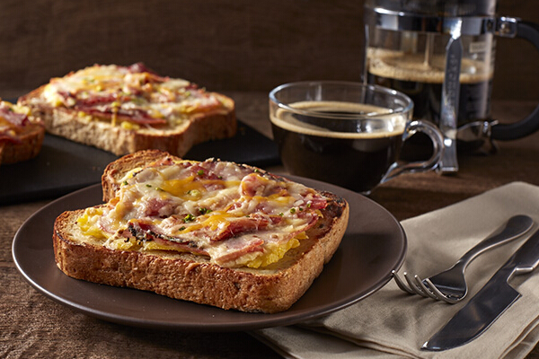Gourmet Toast, P110. This whole wheat toast is topped with egg, bacon, pastrami, and cheese.