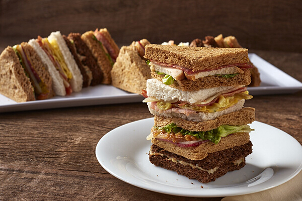 Mixed Sandwiches, P140, an assortment of refreshing and light mini sandwiches with chicken, pastrami, tuna, and turkey, served cold